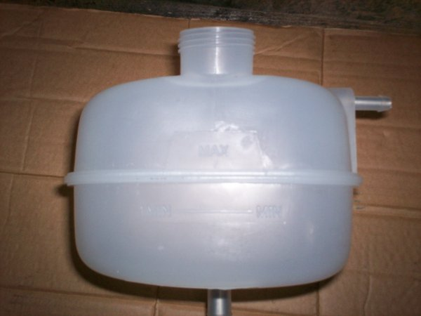 Photo of the Elise plastic header tank lotus spare part